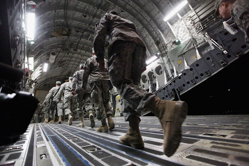 A 2011 photo shows US troops departing from an air base in Iraq.