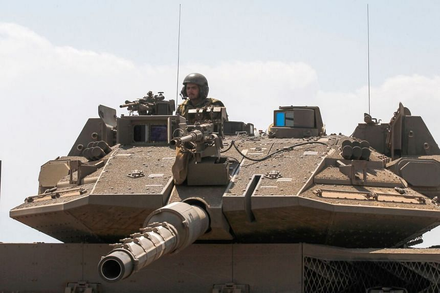 An Israeli soldier mans tank during a military exercise in the Israeli-annexed Golan Heights along the border with Syria on Aug 8, 2018.