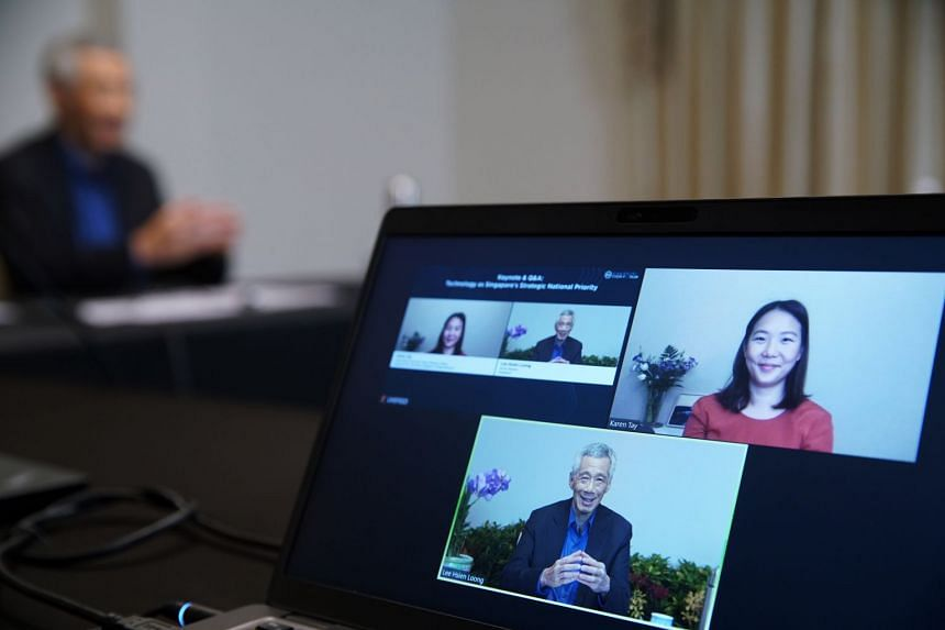 PM Lee taking part in the virtual dialogue at the Singapore Tech Forum.