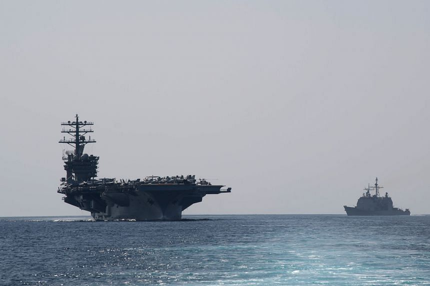 Aircraft carrier USS Nimitz (left) transiting the Strait of Hormuz, on Sept 18, 2020.
