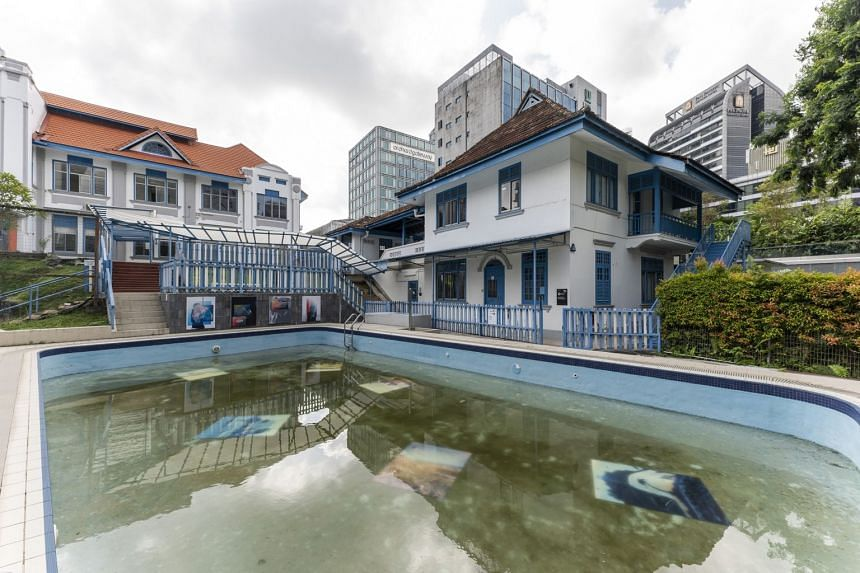 Swimming pool at 37 Emerald Hill, with Argentinian-born artist Seba Kurtis' works Drowned and Talcum.