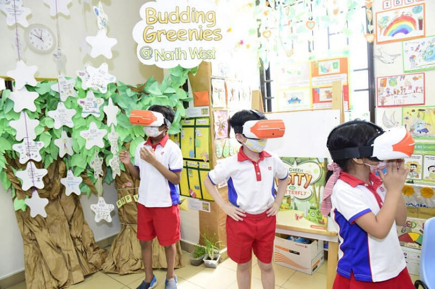 Pre-schoolers at PCF Sparkletots @ Yew Tee Blk 690D experience virtual reality while learning about sustainability.