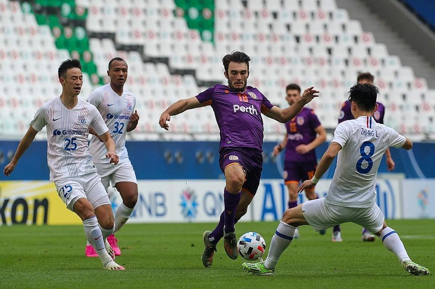 Perth Glory's Nicholas D'Agostino finding no way through the Shanghai Shenhua defence in their Asian Champions League (East) Group F match yesterday. The Chinese side won 2-1 to begin the campaign that was delayed for eight months.