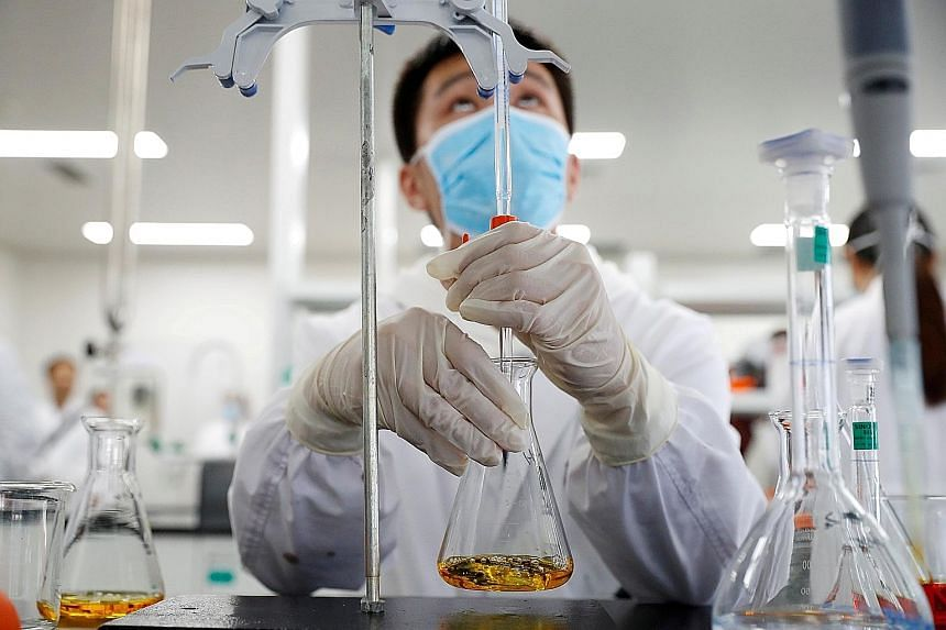 A researcher in a Sinovac Biotech laboratory in Beijing. The Chinese firm's CoronaVac and four other vaccines developed in China are undergoing late-stage trials to determine their effectiveness in preventing Covid-19.