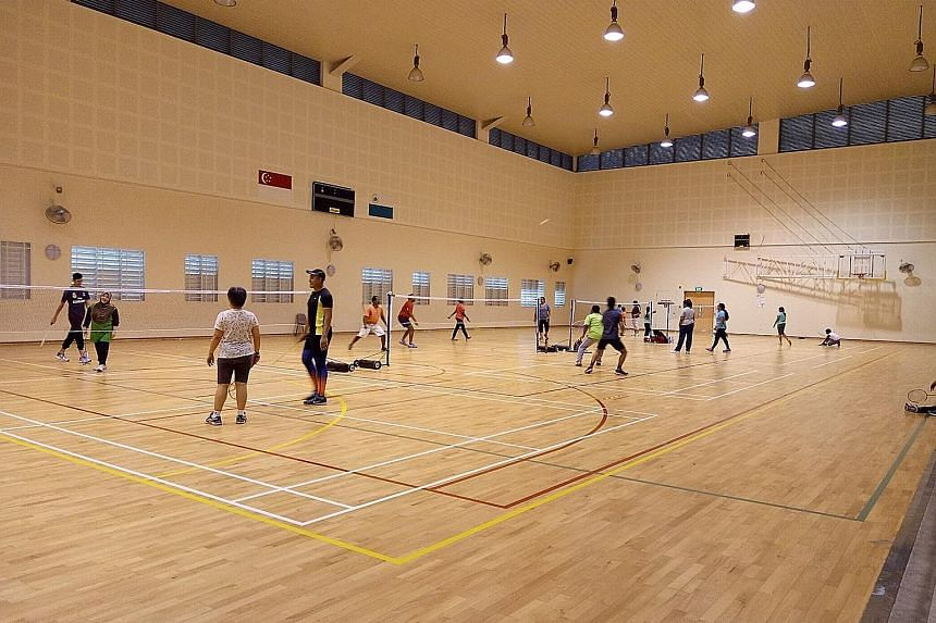 Members of the public playing badminton at the indoor hall of East Spring Primary School, before the Covid-19 pandemic. The hall is one of 169 facilities under the Dual-Use Scheme that will be reopened to the public during the year-end school holiday