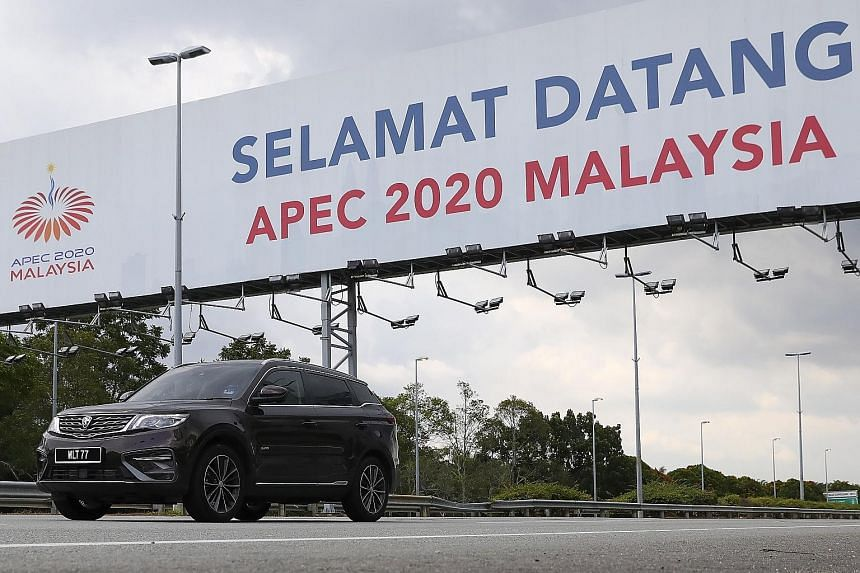 A billboard in Sepang marking the Asia-Pacific Economic Cooperation (Apec) summit, which is chaired by Malaysia this year. Apec economies are working with Malaysia to finalise two outcome documents for tomorrow's virtual Economic Leaders' Meeting: th