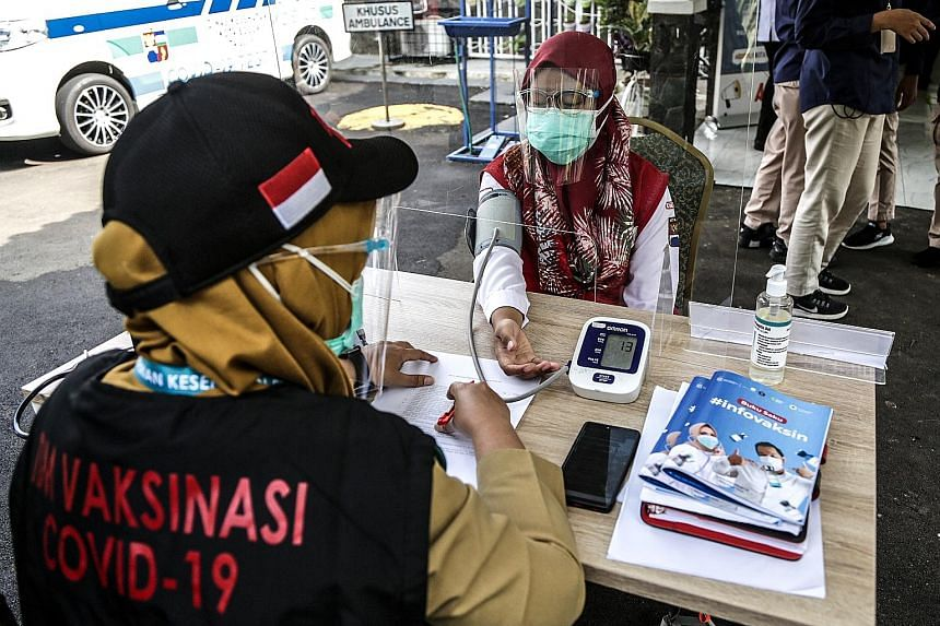 A volunteer taking part in a Covid-19 vaccination drill in Bogor, West Java. Indonesia's state drugmaker Bio Farma and the University of Padjadjaran are jointly conducting a phase three clinical trial of a vaccine candidate, CoronaVac, which is being