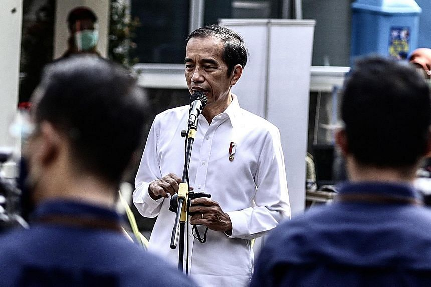Indonesian President Joko Widodo's administration had earlier announced that a vaccination programme will begin this month, but last week told Reuters it will be by the end of this year. PHOTO: AGENCE FRANCE-PRESSE