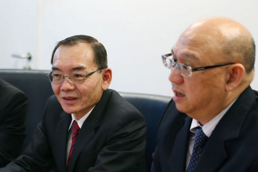 Starburst Holdings executive chairman Edward Lim (left) and managing director Yap Tin Foo interviewed by the CPIB in 2014.