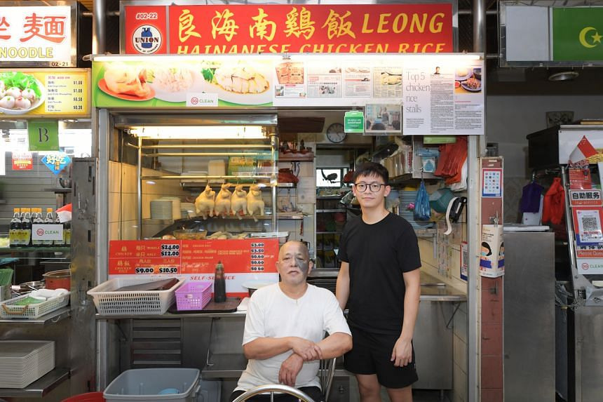 Hawker Neo Cheng Leong, 60, who has been selling chicken rice for 30 years, with his apprentice, Mr Lim Wei Keat, 25, at the Leong Hainanese Chicken Rice stall in Shunfu.