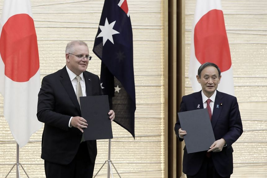 Mr Suga (right) and Mr Morrison agreed on a legal framework allowing both sides to conduct joint military operations.