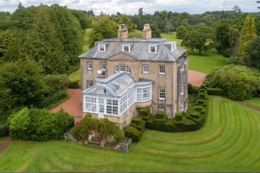 The sprawling Ayrshire estate boasts five bedrooms including two suites, an all-weather tennis court, a wine cellar, and sauna facilities.