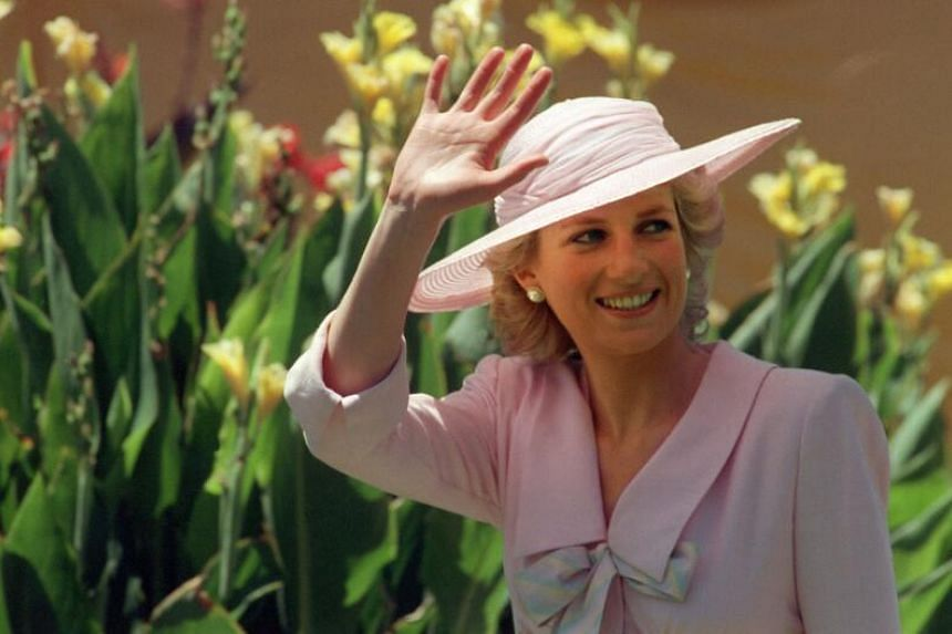 Princess of Wales Diana waves to a crowd in Melbourne on Jan 27, 1988.