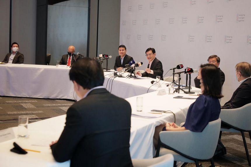 Deputy Prime Minister Heng Swee Keat and National Development Minister Desmond Lee giving an update on the Emerging Stronger Taskforce at PSA Horizons on Nov 19, 2020.
