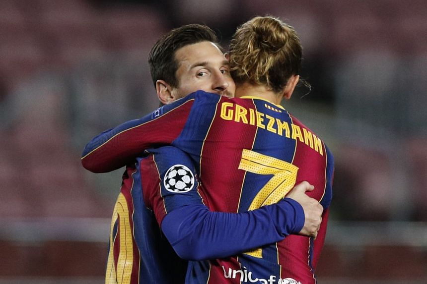 Messi celebrates scoring a goal for Barcelona with Griezmann on Nov 4, 2020.