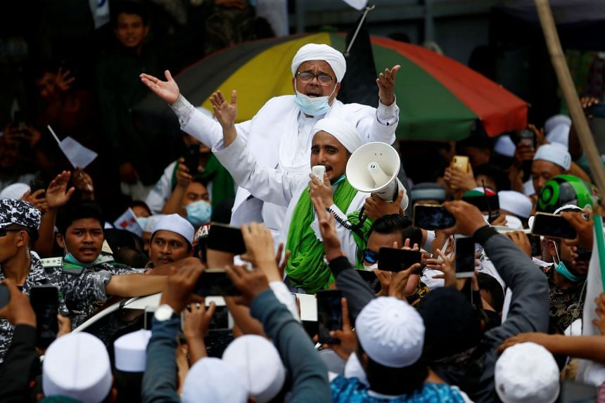 Indonesian cleric Rizieq Shihab is greeted by supporters at the Tanah Abang in Jakarta on Nov 10, 2020.