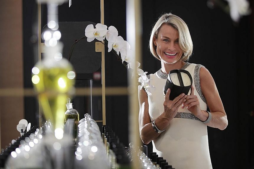 Founder of perfume atelier Maison 21G Johanna Monange launched The Dual Candle (above), which combines two separate scents to create a customised blend. Pass It On candles (above), the brainchild of Ms Michelle Chow (left), also double as pots to gro