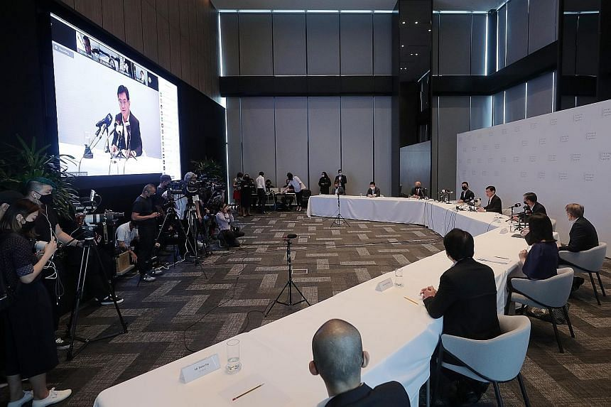 Deputy Prime Minister Heng Swee Keat (centre), chairman of the Future Economy Council, which oversees the task force, speaking to the media yesterday, with members of the Emerging Stronger Taskforce.