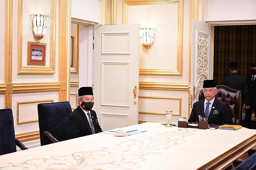 Prime Minister Muhyiddin Yassin (left) with King Sultan Abdullah Ahmad Shah on Wednesday. Sultan Abdullah has advised all lawmakers to approve in an upcoming vote next year's budget in the interests of Malaysia.