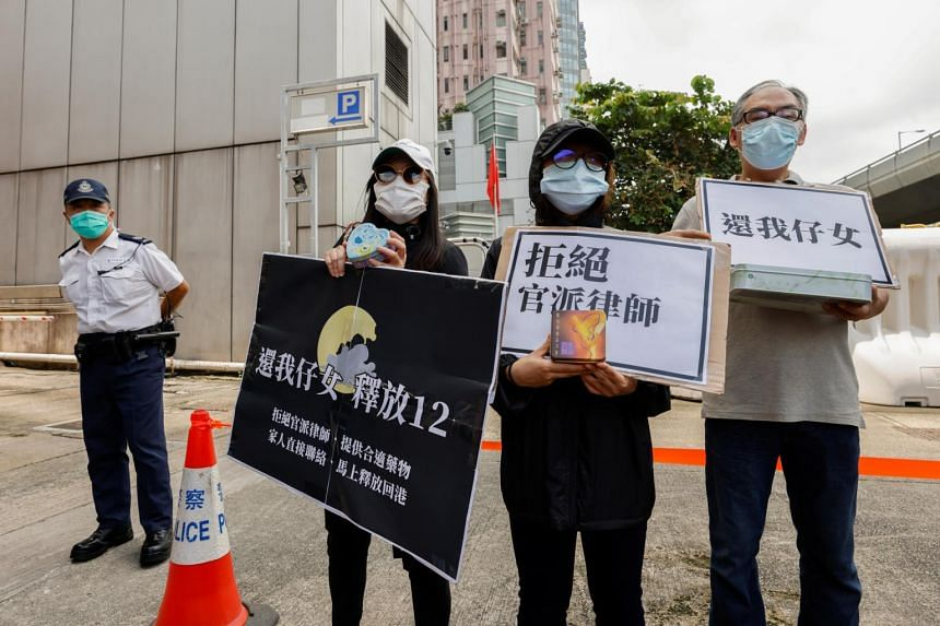 Family members of Hong Kong activists arrested by China protest outside China's Liaison Office in Hong Kong on Sep 30, 2020.