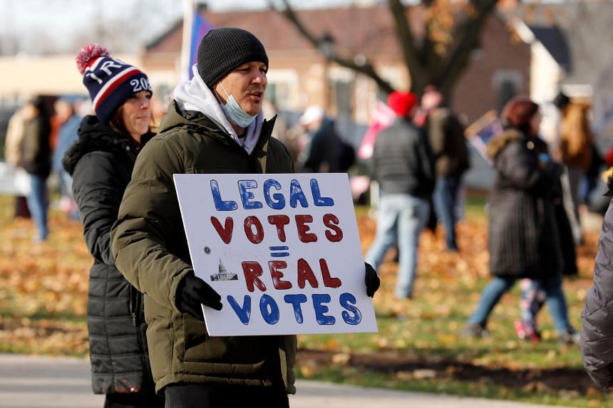 People gather at the Michigan State Capitol for a rally in support of US President Donald Trump on Nov 14, 2020.