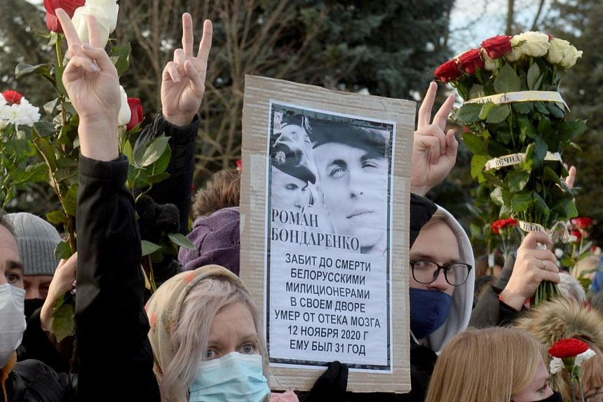 People gather outside a church during a memorial ceremony to anti-government protester Roman Bondarenko in Minsk, Belarus, on Nov 20, 2020.