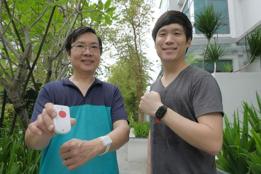 Health monitoring wearables start-up SenzeHub founder George Heng (left) and chief marketing officer Andrew Schil with the IoT-enabled watches and device, on Nov 19, 2020.