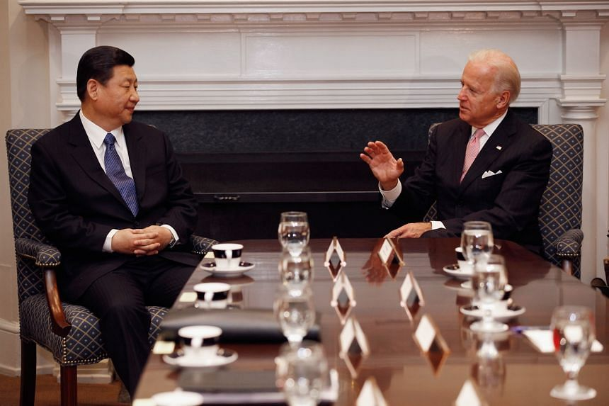 Then Chinese Vice-President Xi Jinping and then US counterpart Joe Biden holding an expanded bilateral meeting in the Roosevelt Room in the White House on Feb 14, 2012.