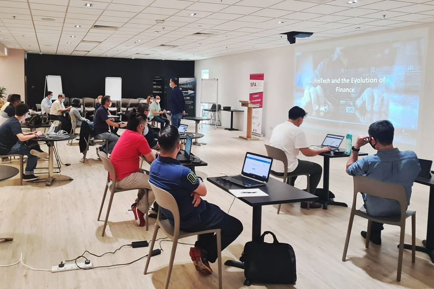 The inaugural batch of SGUS Blockchain Talent Programme trainees during one of their on-campus learning sessions. PHOTO: SINGAPORE POLYTECHNIC