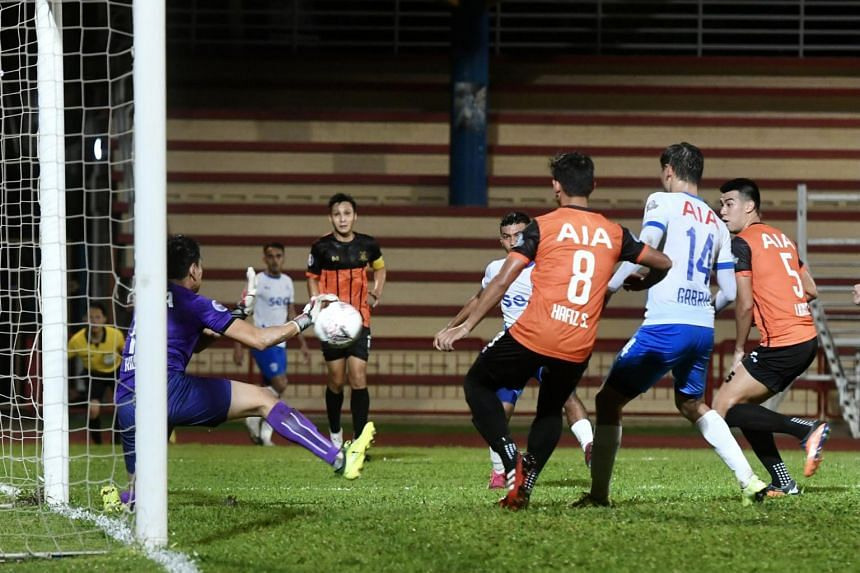 Hougang United's goalkeeper Ridhuan Barudin pulls off a save from Lion City Sailors' Haiqal Pashia's stinging shot during their match on Nov 17, 2020.