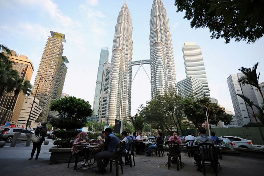 Malaysia's government is seeking to stamp out the virus without hurting businesses by bringing back a national lockdown.