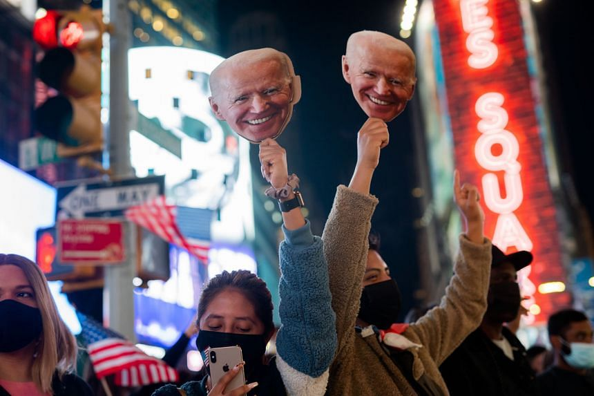 """United States President-elect Joe Biden's supporters celebrating his election win in New York on Nov 7. Singapore's Prime Minister Lee Hsien Loong said he hopes that the Biden administration will take """"a more coherent, systematic approach"""" in the US'"""