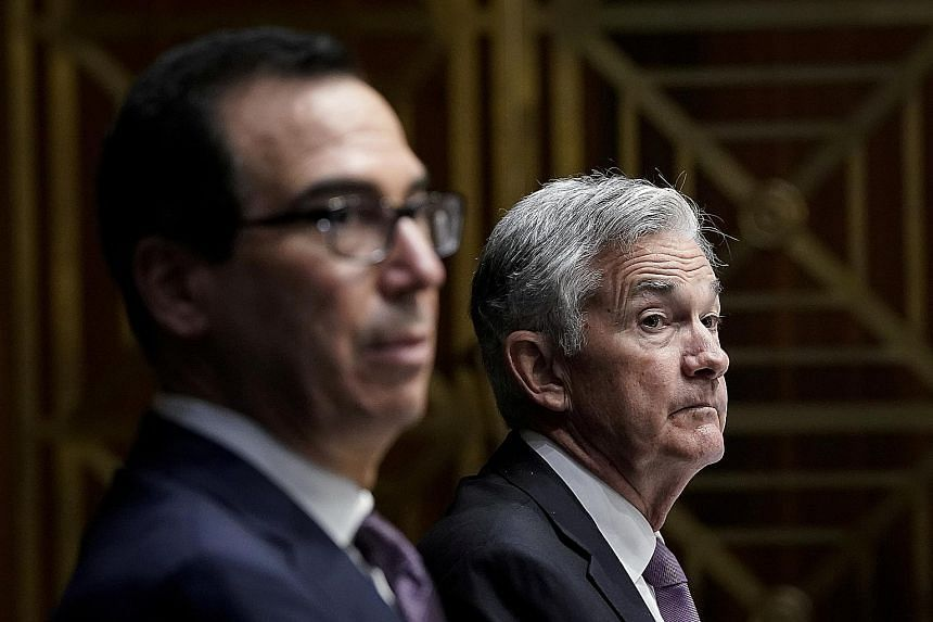 Treasury Secretary Steven Mnuchin (left) and Federal Reserve chair Jerome Powell disagree over whether to keep in place emergency lending facilities designed to shore up the US economy. PHOTO: REUTERS