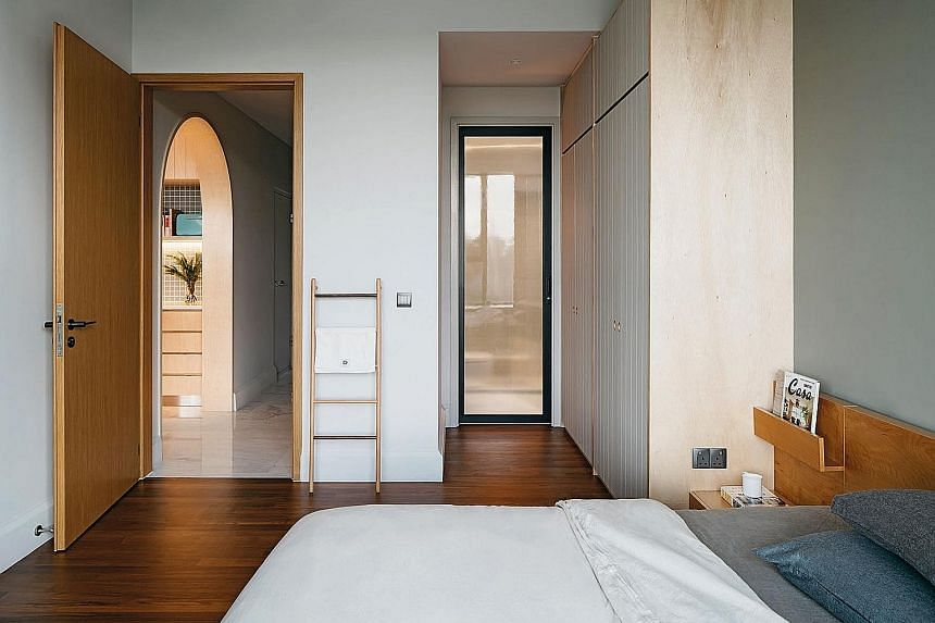 The muted palette gets pops of colour from cupboard doors and bedlinen.
