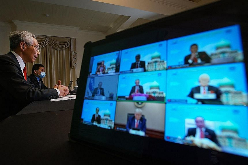 Prime Minister Lee Hsien Loong at the virtual Apec meeting yesterday. Other leaders who joined the virtual summit included Japan's Prime Minister Yoshihide Suga, Russian President Vladimir Putin, Canadian Prime Minister Justin Trudeau and New Zealand