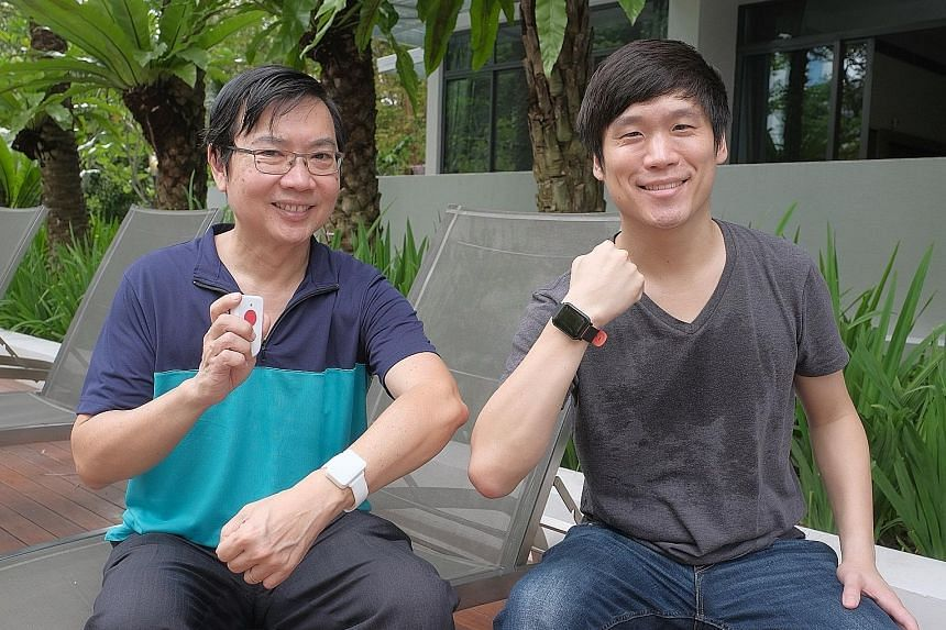 SenzeHub founder and chief executive George Heng (in blue-green top) and chief marketing officer Andrew Schill posing with the Internet-of-Things-enabled watches. These monitor patients' vital signs such as heart rate and temperature. ST PHOTO: GAVIN