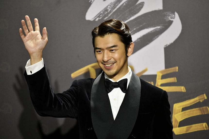Taiwanese actor Chen Bolin arrives on the red carpet at the 57th Golden Horse film awards in Taipei, on Nov 21, 2020.