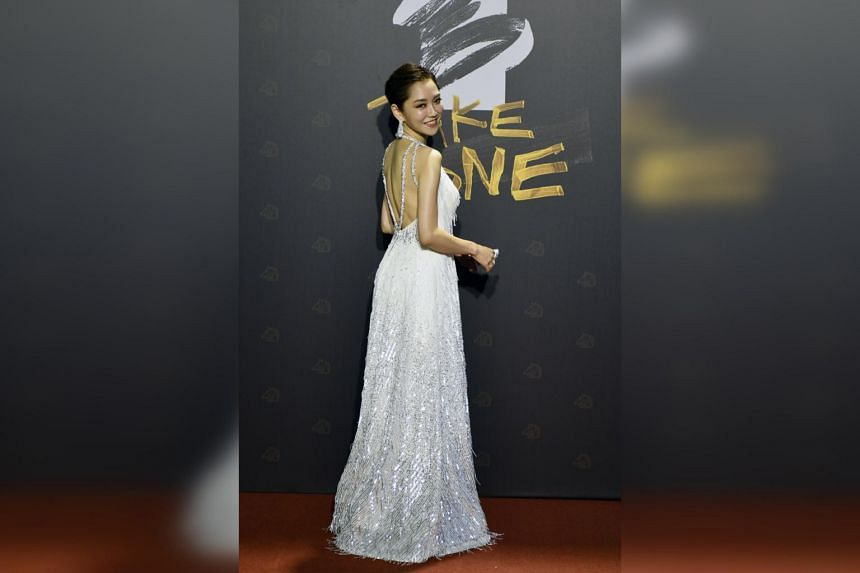Taiwanese actress Pink Yang poses for photographs upon her arrival for the 57th Golden Horse Films Awards in Taipei, on Nov 21, 2020.