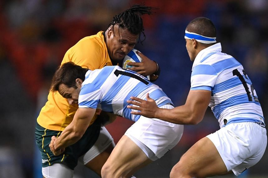 Brandon Paenga-Amosa of the Wallabies is tackled by Juan Imhoff of the Pumas on Nov 21, 2020.