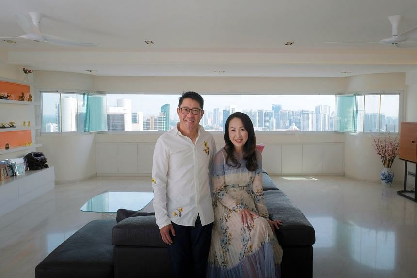 Knight Frank executive Linda Chern with her businessman husband Leslie Tay in their 2,852 sq ft condominium unit at Cairnhill Plaza near Newton that was bought for $3.8 million in 2015.