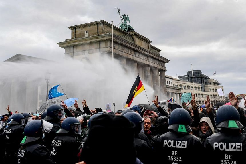Riot police uses a water cannon to break up the demonstration against German coronavirus restrictions on Nov 18, 2020.