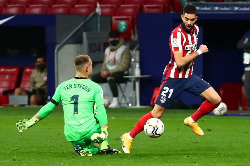 Atletico Madrid's Yannick Carrasco (right) scores their first goal against Barcelona, on Nov 21, 2020.