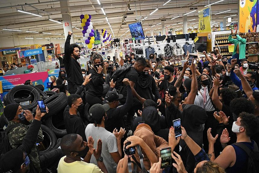 Demonstrators protesting at a Carrefour supermarket in Rio de Janeiro on Friday against the death of a black man beaten by white security guards at one of the chain's branches in Porto Alegre. A video of Thursday night's incident captured on a mobile