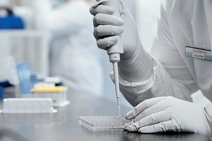 A researcher working in a lab run by Moderna, which says its experimental vaccine is 94.5 per cent effective in preventing Covid-19 based on interim data from a late-stage trial. A vaccine is one of the world's most complex products to produce, says