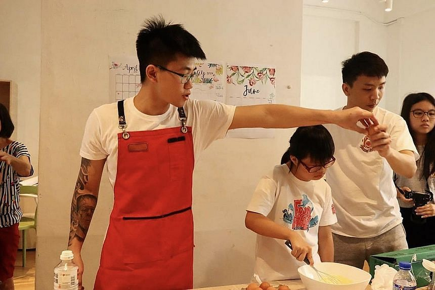Jason (left) and Zhen Long conducting a confidence-building workshop last year for children with special needs from Club Rainbow.
