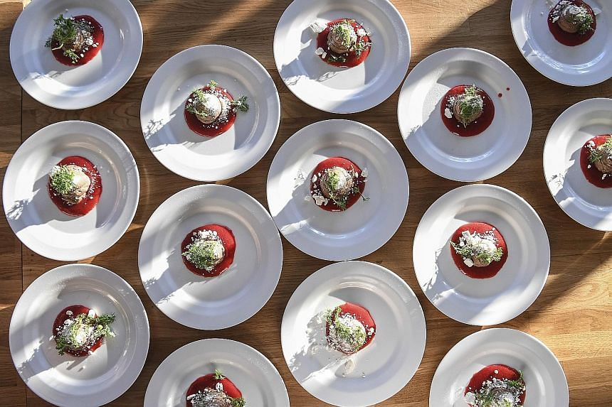 EAT FRESH: Portions of milk chocolate mousse, strawberries and pineapple weed, made with ingredients Finnish chef Jyrki Tsutsunen collects himself from nature. One of the leading advocates of wild food in Finland, he organises culinary events where n