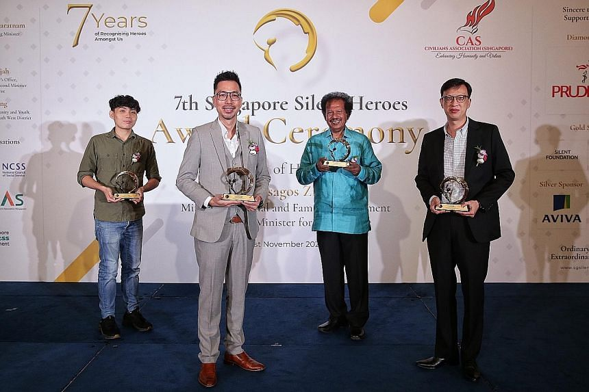 Silent Heroes Award recipients (from left) Derek Lim (Inspiring Youth category), Andrew Ong (Outstanding Adult category), Mashuthoo Abdul Rahiman (Pioneers of Promise category) and Aaron Yeoh (Hearts of Humanity category) at the award ceremony at Sha