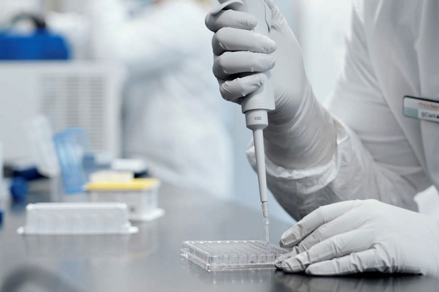 A researcher working in a lab run by Moderna, which says its experimental vaccine is 94.5 per cent effective in preventing Covid-19 based on interim data from a late-stage trial.