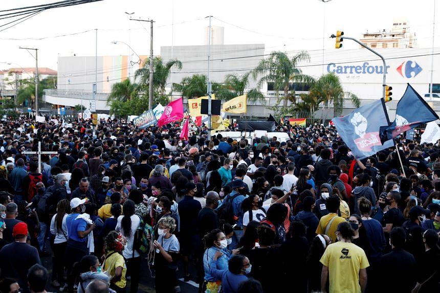 Residents protest against racism after a man was beaten to death by security guards at a Carrefour supermarket in Porto Alegre on Nov 20, 2020.