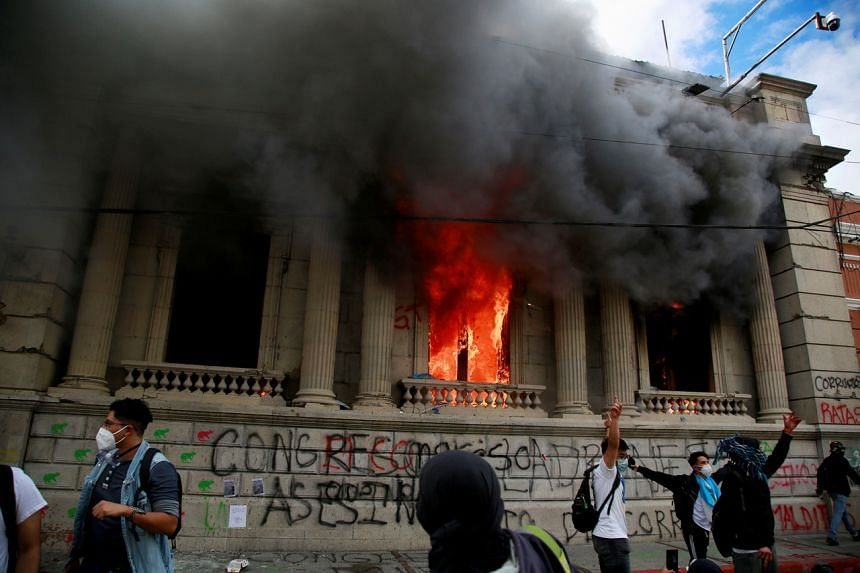 Part of the Congress building is set on fire during an anti-government protest in Guatemala City on Nov 21, 2020.